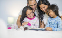 parents and children reading in bed
