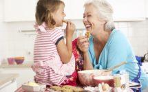 grandmother and granddaughter baking cookies